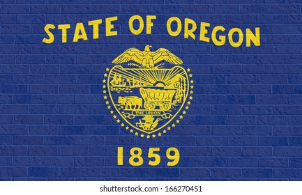 Oregon state flag of America on brick wall, isolated on white background.
