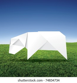 origami cow on grass field