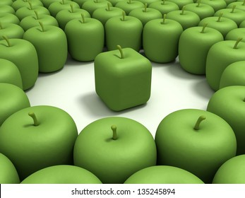 Original apple. Green apple of the cubic form in an environment of usual green apples.
