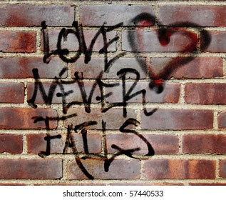 "original graffiti illustration of Corinthians 13 ""love never fails"" layered with a photograph of a brick wall"