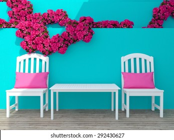 Outdoor patio seating area with white wooden furniture and pink roses.
