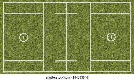 An overhead view of a mens lacrosse playing field with white markings painted on grass.