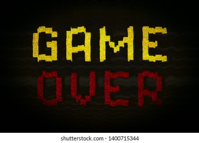 An overly distorted Game Over screen, yellow and red over black, with intentional digital aberrations and artifacts.