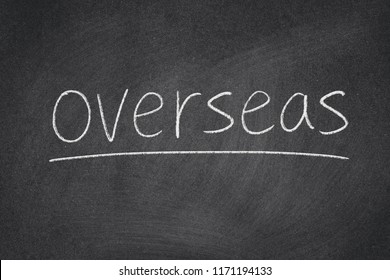 overseas concept word on a blackboard background