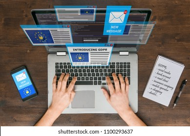 Overwhelmed person receiving dozens of e-mails on GDRP regulations, GDPR and data safety concept