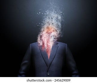 Overworked  businessman standing headless with explosion instead of his head