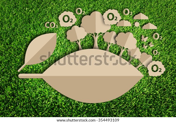 Oxygen. Paper cut of eco on green grass.
