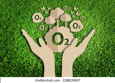 Oxygen. Saving tree. Paper art style of eco on green grass. Save the earth.