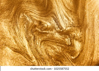 Painted background. Abstract emotional art. Modern design element. Golden liquid acrylic paints. Marble texture.