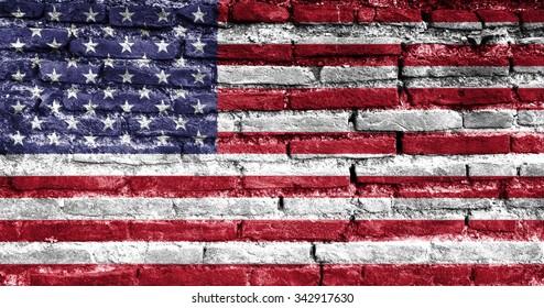 Painted USA flag on brick wall.