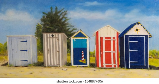 Painting colorful wooden cabins and huts at the beach