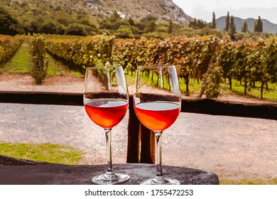 Painting of two glasses of rose wine in a vineyard in Cafayate, Salta, Argentina