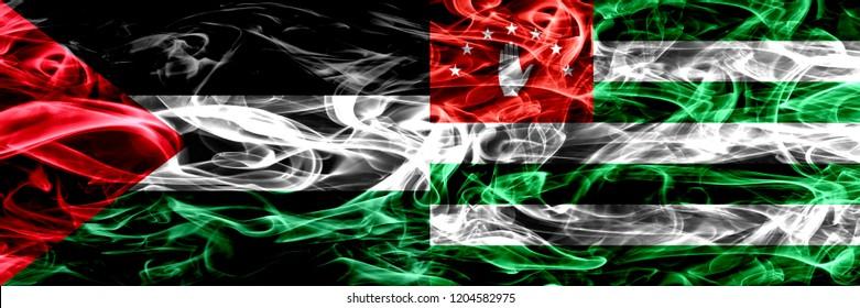 Palestine vs Abkhazia, Abkhazian smoke flags placed side by side. Thick colored silky smoke flags of Palestinian and Abkhazia, Abkhazian