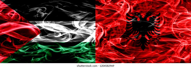 Palestine vs Albania, Albanian smoke flags placed side by side. Thick colored silky smoke flags of Palestinian and Albania, Albanian