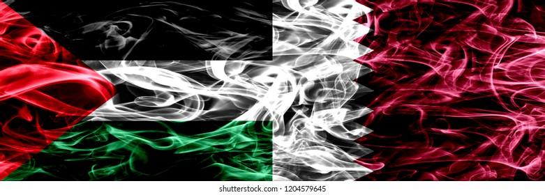 Palestine vs Qatar, Qatari smoke flags placed side by side. Thick colored silky smoke flags of Palestinian and Qatar, Qatari