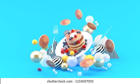 Pancakes and berries among colorful balls on a blue background.-3d rendering.