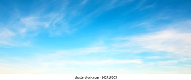 Panorama of blue sky with white clouds in clear weather on a sunny day