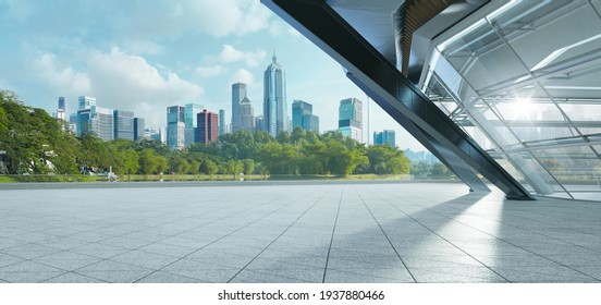 Panoramic view of empty concrete triangle shape floor with steel and glass modern building exterior and cityscape.  Morning scene. Photorealistic 3D rendering.