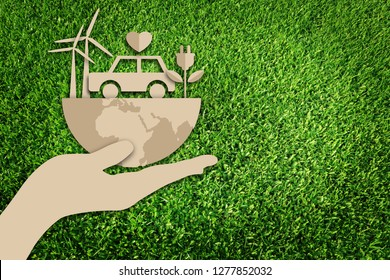 Paper art style of eco car concept on green grass background. Electric cars. Eco friendly car development. Save the earth.