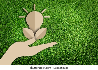 Paper art style of eco concept on green grass background. Energy saving. Save the earth.