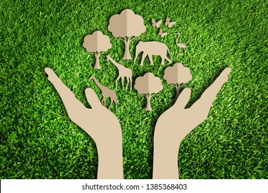 Paper art style of eco concept on green grass background. Save the earth. Save wildlife.
