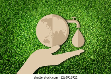 Paper art style of eco on green grass background. Save water concept. Save the earth.