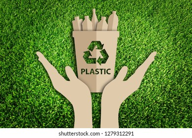 Paper art style of Reuse, Reduce, Recycle concept on green grass. Recycling trash. Save the earth.