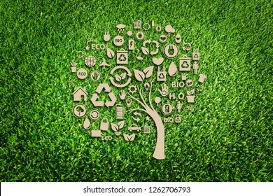 Paper cut of eco concept on green grass background