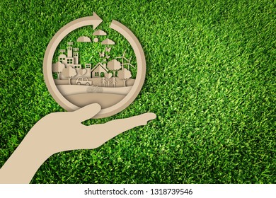 Paper cut of eco concept on green grass background. Save the earth.