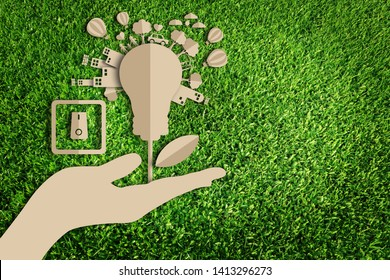 Paper cut of Green city concept on green grass. Energy saving. Save the earth.