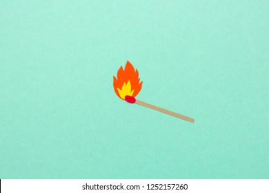 Paper cut match with flame illustration