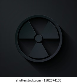 Paper cut Radioactive icon isolated on black background. Radioactive toxic symbol. Radiation Hazard sign. Paper art style.