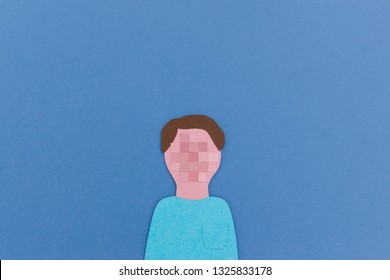Paper cutout of human portrait with pixeled face instead of face for concept of anonymity