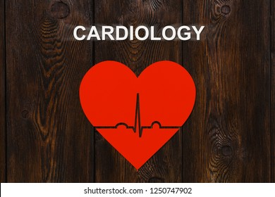 Paper heart with echocardiogram with text CARDIOLOGY. Abstract conceptual image