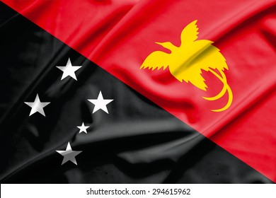 papua new guinea flag on soft and smooth silk texture