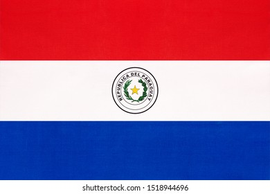 Paraguay national fabric flag, textile background. Symbol of international south america world country. Paraguayan state official sign.