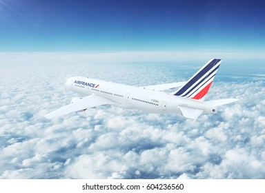 PARIS, FRANCE - CIRCA 2017: In-flight view of Air France Boeing 777 Commercial Passenger Aircraft Flying High Up in the Sky Above the Clouds. 3D Illustration.