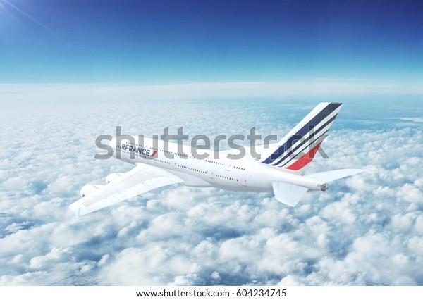 PARIS, FRANCE - CIRCA 2017: In-flight view of Air France Airbus A380 Commercial Passenger Aircraft Flying High Up in the Sky Above the Clouds. 3D Illustration.