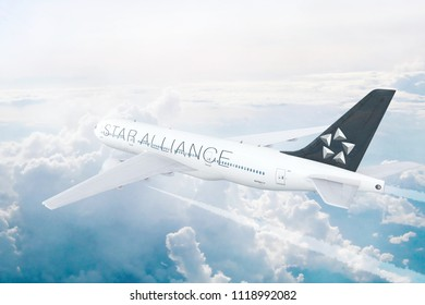 PARIS, FRANCE - JUNE 17:  Star Alliance Group Member aircraft flying high above the clouds. 3D Illustration.