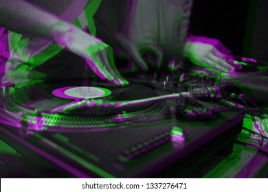 Party dj scratches vinyl records with hip hop music on vintage turn table player.Illustration edited with 3d stereo effect.Hands of concert disc jockey scratching record on retro turntables