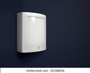 A passive infrared sensor (PIR) on a dark blue-gray wall