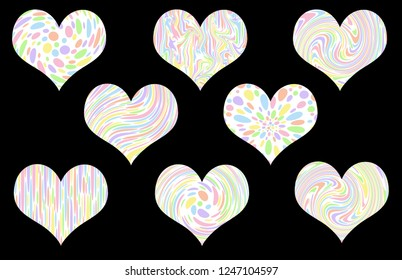 Pastel patterned valentine hearts – isolated on a black background