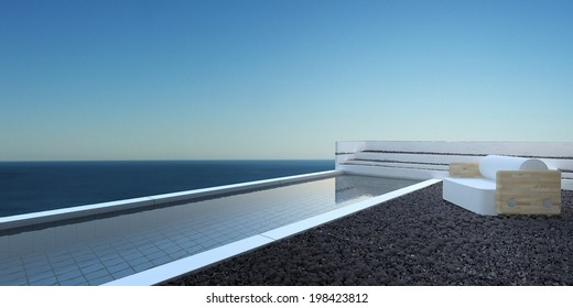 Patio landscaped with pebbles with a swimming pool and comfortable seating overlooking the ocean against a blue sunny sky