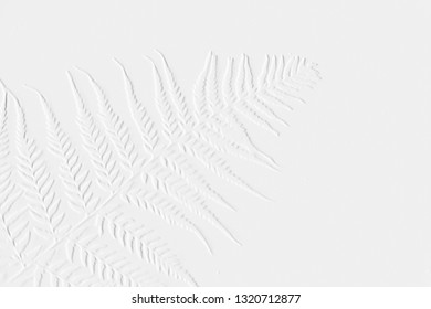 Pattern of embossed leaves with background grey can be use for card background,wallpaper and have space for text -