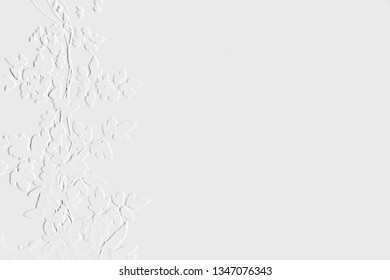 Pattern of embossed leaves with background light grey can be use as wallpaper ,screen and useful background