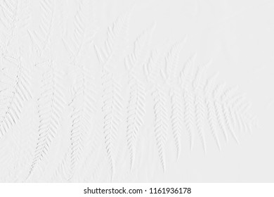 Pattern of embosses leaves and flowers with grey background