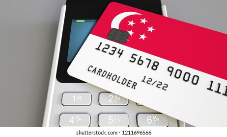 Payment or POS terminal with credit card featuring flag of Singapore. Singaporean retail commerce or banking system conceptual 3D rendering