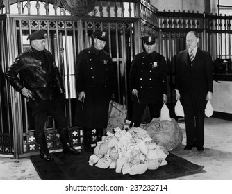 Payroll money for Detroit Workers Police guard money arriving at the Chrysler Emergency Bank in Detroit The Michigan Governor Comstock suspended regular banking for 10 days in Feb.