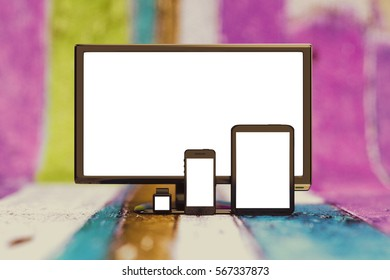 PC computer monitor, tablet, smartphone and smartwatch with empty blank screens. Template for responsive design website presentation. 3D illustration background.