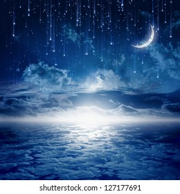 Peaceful background, blue night sky with moon, stars, beautiful clouds, glowing horizon